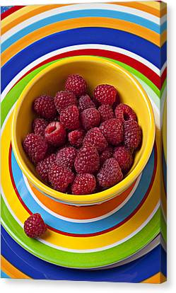 Raspberries In Yellow Bowl On Plate Canvas Print by Garry Gay