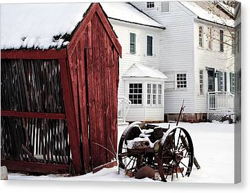Red Barn In Winter Canvas Print by John Rizzuto