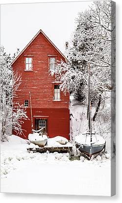 Red Boathouse In The Snow Canvas Print by Benjamin Williamson