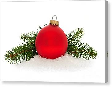 Red Christmas Bauble Canvas Print by Elena Elisseeva