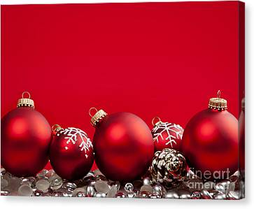 Red Christmas Baubles And Decorations Canvas Print by Elena Elisseeva