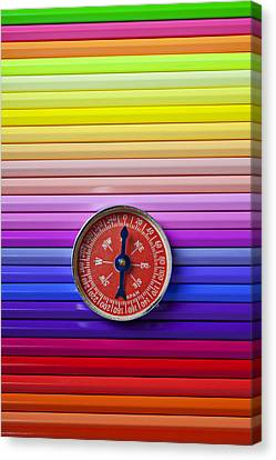 Red Compass On Rolls Of Colored Pencils Canvas Print by Garry Gay