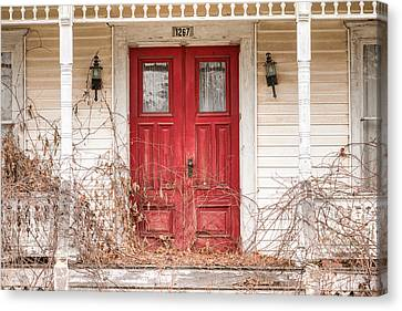 Red Doors - Charming Old Doors On The Abandoned House Canvas Print by Gary Heller