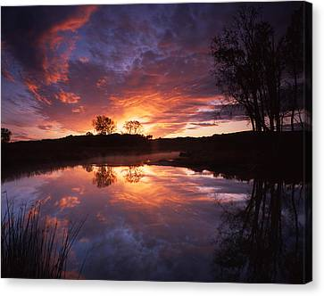 Red Glow In The Morn Canvas Print by Ray Mathis