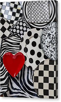 Red Heart Plate On Black And White Plates Canvas Print by Garry Gay