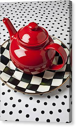 Red Teapot On Checkerboard Plate Canvas Print by Garry Gay