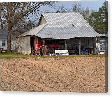 Red Tractor In A Tin Roofed Shed Canvas Print by Paulette B Wright