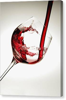 Red Wine Pouring Into A Glass Canvas Print by Richard Desmarais