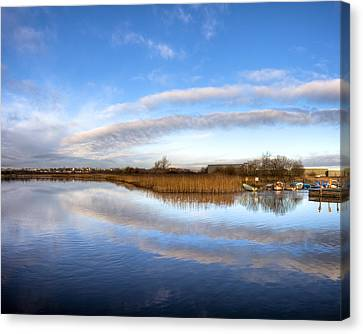Reflecting Skies On The River Corrib In Galway Canvas Print by Mark E Tisdale