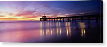 Reflection Of A Pier In Water Canvas Print by Panoramic Images