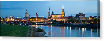 Reflection Of Buildings On Water Canvas Print by Panoramic Images
