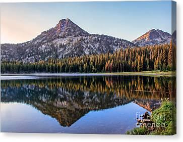 Reflection Of Gunsight Mountain Canvas Print by Robert Bales