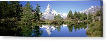 Reflection Of Trees And Mountain Canvas Print by Panoramic Images