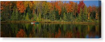 Reflection Of Trees In Water Canvas Print by Panoramic Images