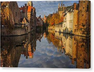 Reflections Of Bruges Canvas Print by Chris Fletcher