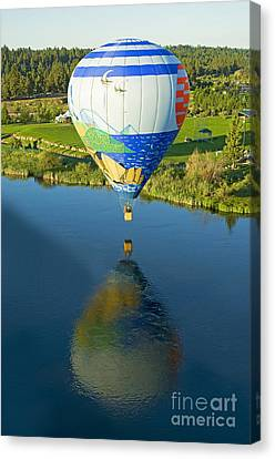 Reflections Over The Dechutes Canvas Print by Nick  Boren