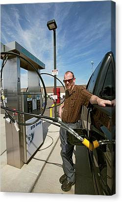 Refuelling A Natural Gas Vehicle Canvas Print by Jim West