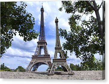 Replica Eiffel Tower Next To The Real Eiffel Tower Canvas Print by Bernard Jaubert