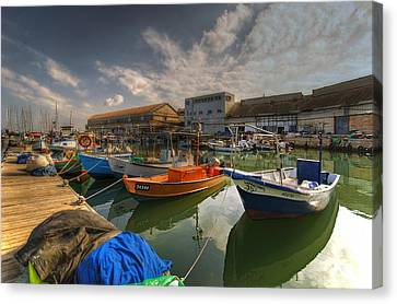 resting boats at the Jaffa port Canvas Print by Ron Shoshani