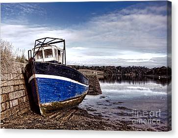 Retired Boat Canvas Print by Olivier Le Queinec