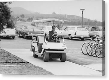 Richard Nixon Driving A Golf Cart Canvas Print by Everett