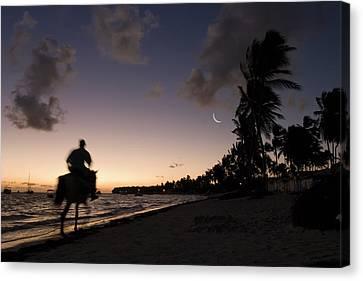 Riding On The Beach Canvas Print by Adam Romanowicz