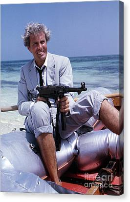 Rik Van Nutter On A Raft On The Set Of Thunderball Canvas Print by The Phillip Harrington Collection