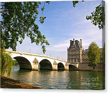 River Seine And The Pont Royal. Canvas Print by Alex Cassels