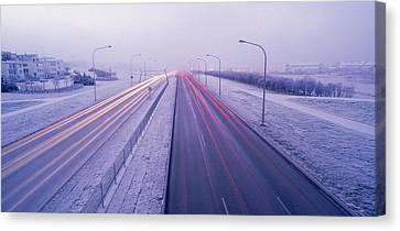 Road Running Through A Snow Covered Canvas Print by Panoramic Images