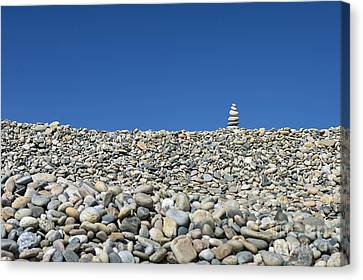 Rock Cairn On Stonewall Beach Canvas Print by John Greim