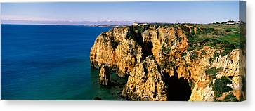 Rock Formations In The Ocean, Lagos Canvas Print by Panoramic Images