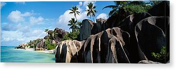 Rock Formations On The Beach, Anse Canvas Print by Panoramic Images