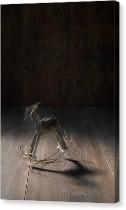 Rocking Horse With Blur Canvas Print by Amanda Elwell
