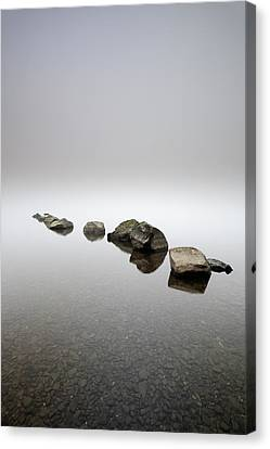 Rocks In The Mist Canvas Print by Grant Glendinning