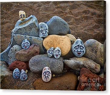 Rocky Faces In The Sand Canvas Print by David Smith