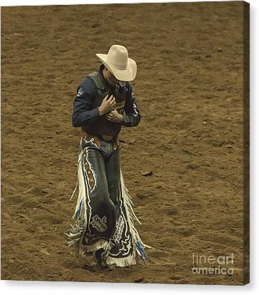 Rodeo Cowboy Dusting Off Canvas Print by Janice Rae Pariza