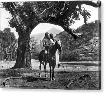 Romantic Kiss On Horseback Canvas Print by Underwood Archives
