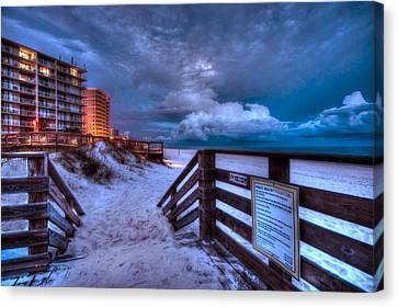 Romar Beach Clouds Canvas Print by Michael Thomas