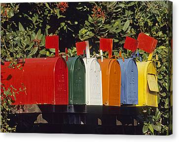 Row Of Colorful Mailboxes Canvas Print by David Litschel