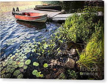 Rowboat At Lake Shore At Dusk Canvas Print by Elena Elisseeva