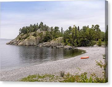 Rugged Cliffs And Pebble Beach Canvas Print by Panoramic Images