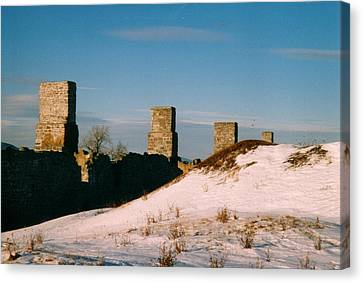 Ruins With Snow And Blue Sky Canvas Print by David Fiske