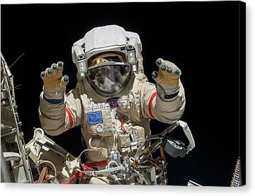 Russian Cosmonaut During A Spacewalk Canvas Print by Nasa
