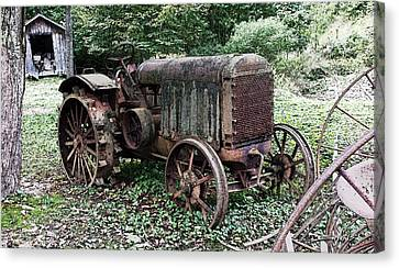 Rusted Mc Cormick-deering Tractor And Shed Canvas Print by Michael Spano