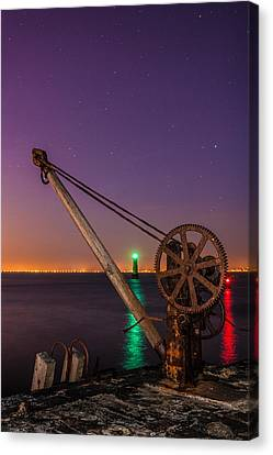 Rusty Davit And Two Lighthouses Canvas Print by Semmick Photo