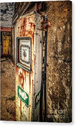 Rusty Gas Pump Canvas Print by Adrian Evans