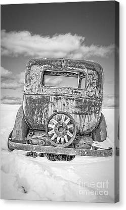 Rusty Old Car In The Snow Canvas Print by Edward Fielding