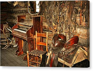 Saddle And Piano Canvas Print by Marty Koch