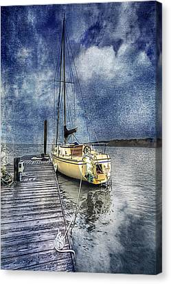 Sailboat At The Dock Canvas Print by Debra and Dave Vanderlaan