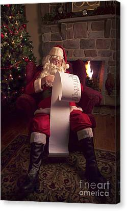 Santa Checking His List Canvas Print by Diane Diederich
